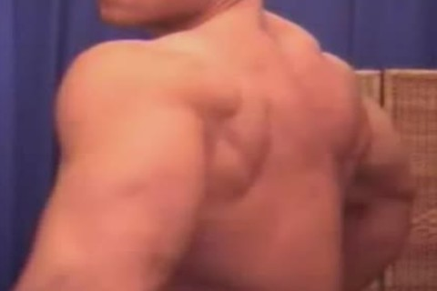 Bald body builder shows off his awesome body